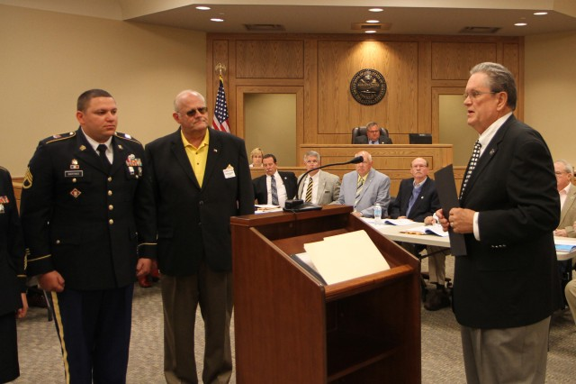 "Army Reserve Ambassador for Tennessee John Dyess speaks to the Washington County Council in Jonesborough, Tenn. about the 105th birthday of the Army Reserve and the importance of the warrior citizen. ""A good job done by anybody needs to be recognized, and service to this nation is more important, I think now, than ever,"" Dyess said. ""And these people who willingly put on this nation's uniform and go in harm's way for me, my family, yours and our way of life deserve our faith."" Also pictured are Staff Sgt. Joseph Martinez of the 702nd Engineer Company and Ernie Rumsby, president of the Tri-Cities Military Affairs Council. The Army Reserve originally started as the Medical Reserve Corps in 1908, but became an active military branch after World War I. The mission of the US Army Reserve is to provide trained, equipped and ready soldiers but also to help with aid after natural disasters and with civil support. Today, more than 200,000 Americans are enlisted in the Army Reserve ready for combat when called upon."