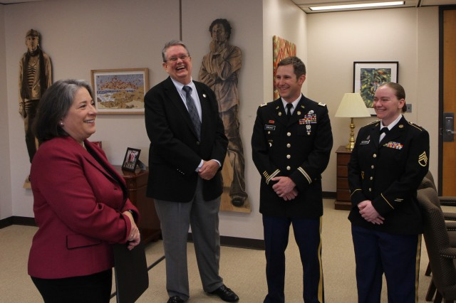 Madeline Rogero, Mayor of Knoxville, Tennessee, shares a light moment with Army Reserve Soldiers on the 105th birthday of the Army Reserve. Pictured from left to right are, Mayor Rogero, Army Reserve Ambassador for Tennessee John Dyess, 2nd Lt. Michael Sweany and Staff Sgt. Amy Reesman of the 489th Civil Affairs Battalion. Mayor Rogero presented them, along with other Soldiers in attendance, with a proclamation commemorating the Army Reserve birthday and spoke to each Soldier in turn, thanking them for their service. The Army Reserve originally started as the Medical Reserve Corps in 1908, but became an active military branch after World War I. The mission of the US Army Reserve is to provide trained, equipped and ready soldiers but also to help with aid after natural disasters and with civil support. Today, more than 200,000 Americans are enlisted in the Army Reserve ready for combat when called upon.