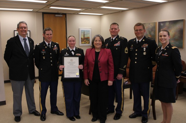 Madeline Rogero, Mayor of Knoxville, Tennessee, stands with Army Reserve Soldiers on the 105th birthday of the Army Reserve. Pictured from left to right are, Army Reserve Ambassador for Tennessee John Dyess, 2nd Lt. Michael Sweany and Staff Sgt. Amy Reesman of the 489th Civil Affairs Battalion, Mayor Rogero, Sgt. 1st Class Brian Heller, 489th CA, Sgt. 1st Class Fred Blanke and 1st Lt. Anna McDonald of the 844th Engineer Battalion. Mayor Rogero presented them with a proclamation commemoration the Army Reserve birthday and spoke to each Soldier in turn, thanking them for their service. The Army Reserve originally started as the Medical Reserve Corps in 1908, but became an active military branch after World War I. The mission of the US Army Reserve is to provide trained, equipped and ready soldiers but also to help with aid after natural disasters and with civil support. Today, more than 200,000 Americans are enlisted in the Army Reserve ready for combat when called upon.