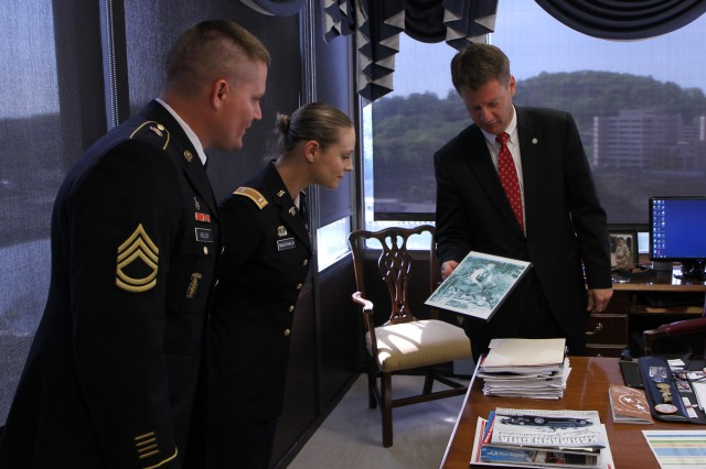 Tim Burchett, right, the Mayor of Knox County, Tenn., shows a picture of his father as a young Marine taken in the Pacific during WWII to Army Reserve Soldiers in Knoxville on April 23. Sgt. 1st Class Brian Heller of the 489th Civil Affairs battalion and 1st Lt. Anna McDonald of the 844th Engineer Battalion joined other Army Reserve Soldiers in the Mayor's officer to commemorate the 105th birthday of the Army Reserve. The Army Reserve originally started as the Medical Reserve Corps in 1908, but became an active military branch after World War I. The mission of the US Army Reserve is to provide trained, equipped and ready soldiers but also to help with aid after natural disasters and with civil support. Today, more than 200,000 Americans are enlisted in the Army Reserve ready for combat when called upon.