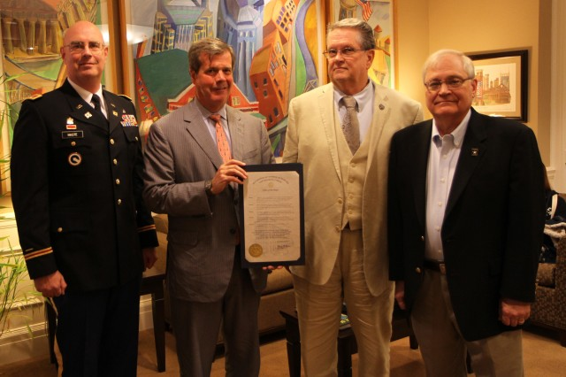 Karl Dean, second from left, the Mayor of Nashville and Davidson county, holds a proclamation to commemorate the 105th birthday of the Army Reserve  on April 24. He is joined by Col. Robert Haste, commander of the 38th Regional Support Group of Charleston, W.V., left, and Army Reserve Ambassador for Tennessee John Dyess and Doug Gilbert, far right, the Employer Partnership field representative Tennessee, Kentucky and northern Alabama. The Army Reserve originally started as the Medical Reserve Corps in 1908, but became an active military branch after World War I. The mission of the US Army Reserve is to provide trained, equipped and ready soldiers but also to help with aid after natural disasters and with civil support. Today, more than 200,000 Americans are enlisted in the Army Reserve ready for combat when called upon.