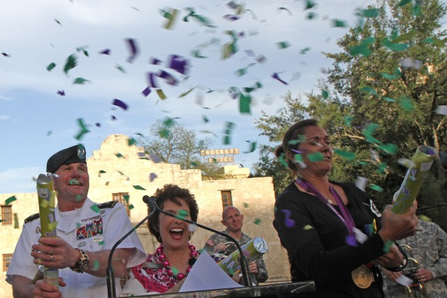 "SAN ANTONIO "" Maj. Gen. Perry Wiggins (left), Marilyn Eldridge (center) and Misty May-Treanor set off confetti poppers at the Alamo April 18 to signal the official beginning of the 2013 Fiesta celebration. Approximately 3.5 million people are expected to attend over the course of the 11-day Fiesta extravaganza, which will include more than 100 events, said Eldridge. Wiggins is the deputy commanding general for U.S. Army North (Fifth Army); Eldridge is the president of the San Antonio Fiesta Commission; and Treanor is a three-time Olympic gold medalist and one of the most successful female beach volleyball players."