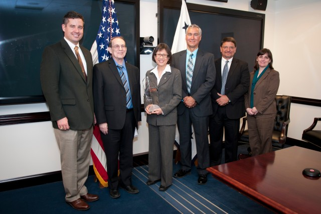 The U.S. Army has been named one of the 2012 Top100 Global Innovators by Thomson Reuters, the multimedia and information conglomerate. Pictured with the award are Dale A. Ormond, director of the Army Research, Development and Engineering Command; Ronald E. Meyers of the Army Research Laboratory; Heidi Shyu, assistant secretary of the Army for Acquisition, Logistics and Technology; John E. Nettleton of the Communications-Electronics Research, Development and Engineering Center; Bartley Durst of the Engineer Research and Development Center (Corps of Engineers); and Mary Miller, deputy assistant secretary of the Army for Research and Technology.
