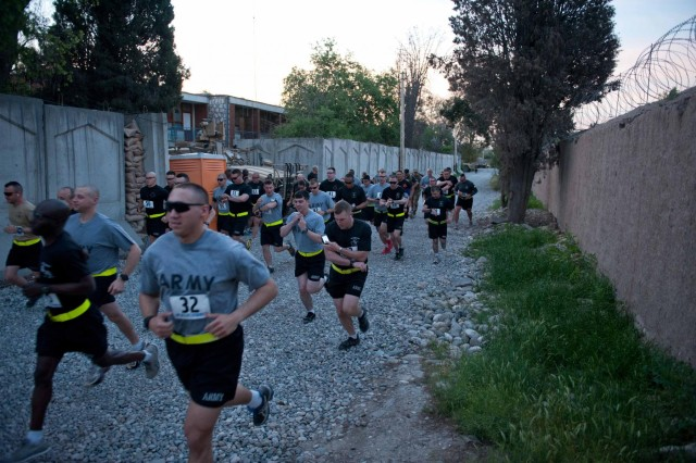 Participants begin the Sgt. Cable running of the bulldogs memorial half-marathon, at Forward Operating Base Finley-Shields in Nangarhar province, Afghainstan, April 28, 2013. (U.S. Army National Guard photo by Spc. Margaret Taylor/Released)