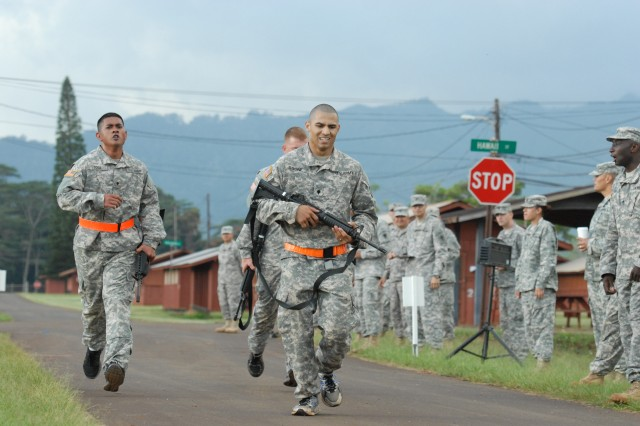 Spc. William Tosie (left), medical readiness specialist with the 8th Special Troops Battalion, and Spc. David Boone (center), military police officer with the 8th Military Police Brigade, race toward the finish line during the 8th Theater Sustainment Command's Best Warrior Competition at Schofield Barracks, Hawaii, Apr. 23.