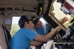 Tristan Randall (left) and Andrew Buck (right) check out the thickness of the windshield glass on a Mine Resistant Ambush Protected vehicle at the Fort A.P. Hill Earth and Safety Day on April 18. Rand