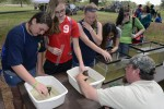 Johnathan Harris, an Aquatic Biologist with the Virginia Department of Game and Inland Fisheries (sitting) brought some turtles, fish and a frog to the Fort A.P. Hill Earth and Safety Day on April 18.