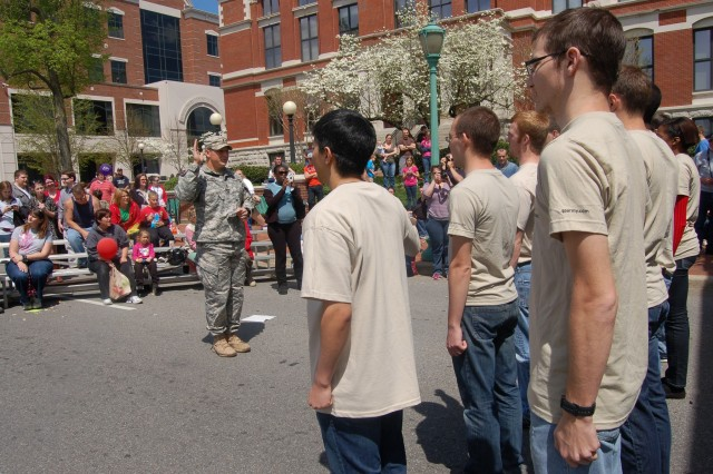 Army Reserve 1st Lt. Collin Mooney leads future Soldiers from the Clarksville Recruiting Center in the oath of enlistment during an April 20, 2013, ceremony at the Rivers & Spires Festival in Clarksville, Tenn.