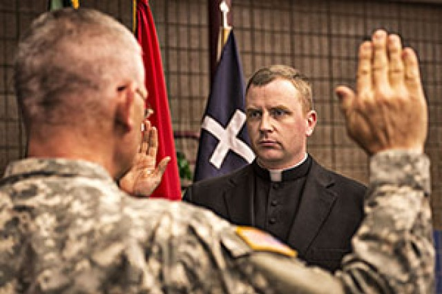 Monsignor Chad Gion is sworn in and commissioned as a 1st Lieutenant for the North Dakota National Guard
