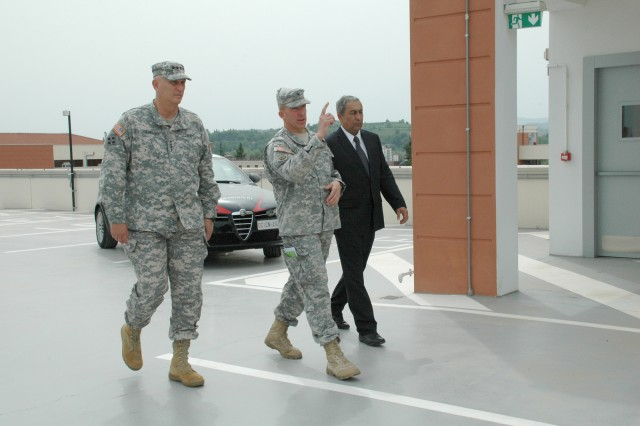 Chief of Staff of the Army Gen. Raymond T. Odierno (left) visits the new facilities at Caserma Del Din in the Vicenza Military Community with U.S. Army Garrison Commander Col. David Buckingham (center) and Director, DPW Kambiz Razzaghi in Vicenza, Italy, May 1, 2013. Highlights of the tour included a community town hall, Army Community Services, and lunch with Soldiers.