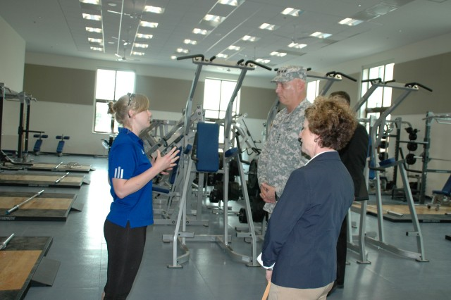 Anne Connor, Fitness Center manager at Del Din, briefs Chief of Staff of the Army Gen. Raymond T. Odierno and his wife Linda during their visit to the Vicenza Military Community in Vicenza, Italy, May 1, 2013.