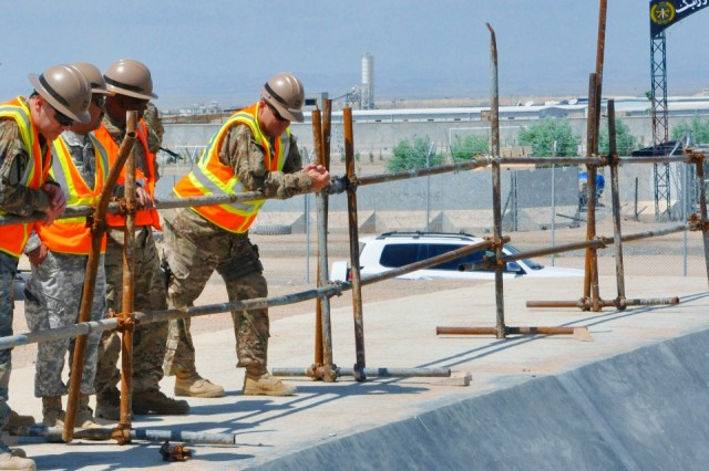 U.S. Army Reserve Lt. Col. Clifford A. Conklin (right) inspects workmanship on a waste water treatment system at Camp Shorabak, an Afghan National Security Forces facility in Helmand province.