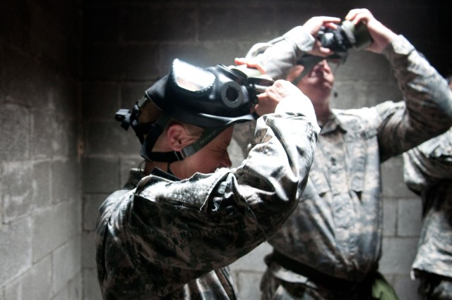 Capt. Robyn E. Boehringer, commander of Company F, 2nd Battalion, 504th Parachute Infantry Regiment, 1st Brigade Combat Team, 82nd Airborne Division, lifts her field protective mask from her face, April 29, 2013, during annual gas chamber training held for her paratroopers on Fort Bragg, N.C. Boehringer entered the gas chamber with each squad of soldiers she sent through the chamber.