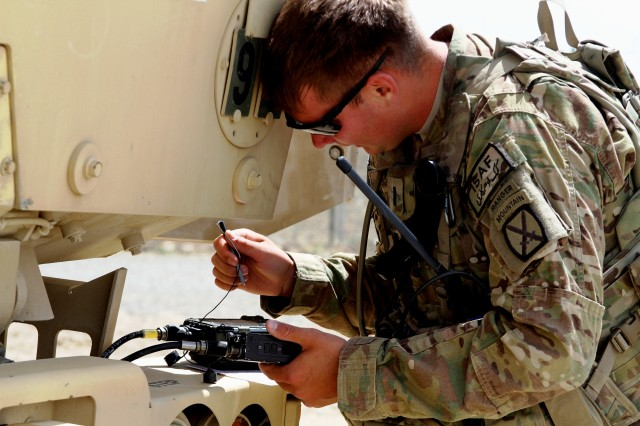 "PAKTIKA PROVINCE, Afghanistan""U.S. Army 1st Lt. Matthew Laney programs his AN/PRC-152 Tactical Radio for a tactical satellite operation during the first 1st Squadron, 89th Cavalry Regiment, H. J. McChrystal Competition at Forward Operating Base Sharana April 26, 2013. (U.S. Army photo by 1st Lt. Jason Sexton)"