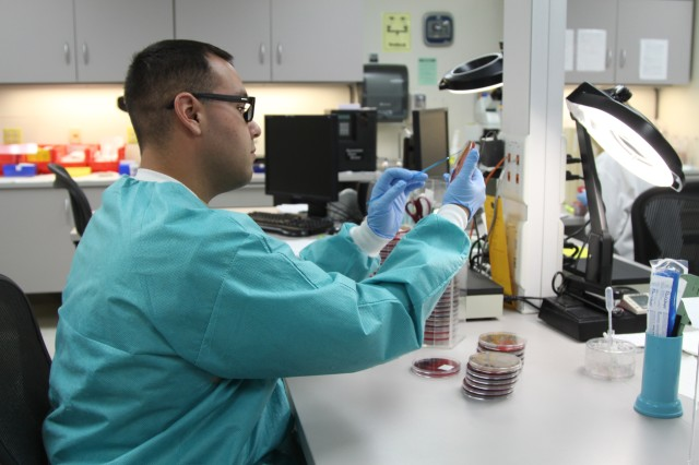 Sgt. Ricardo Arenas swabs a culture plate to check for strep that may be growing on it April 25, 2013, at Reynolds Army Community Hospital at Fort Sill. Other tests routinely performed in the lab include screening for Hepatitis A and B, blood typing, pregnancy and drug screening.