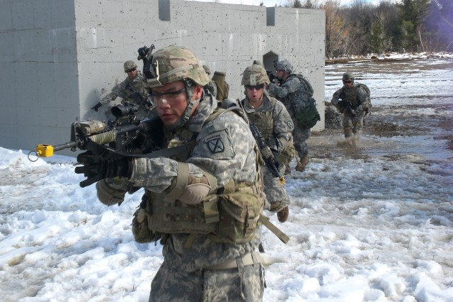 Soldiers assigned to 3rd Platoon, A Company (Immortals), 4th Battalion, 31st Infantry Regiment, 2nd Brigade Combat Team, moves through a village to clear it of enemy forces during a platoon live-fire exercise.