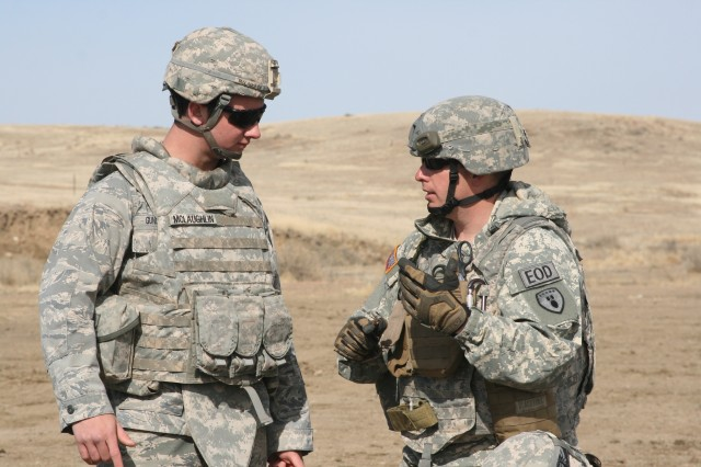FORT CARSON, Colo. -- Staff Sgt. Michael Smith, right, 663rd Ordnance Company, 242nd Explosive Ordnance Disposal Battalion, 71st Ordnance Group (EOD), talks with U.S. Air Force Academy Cadet 1st Class Dan Gunderson, April 24 during a joint service exercise. EOD Soldiers hosted a demolition range for the cadets to provide them with hands-on experience with explosives.