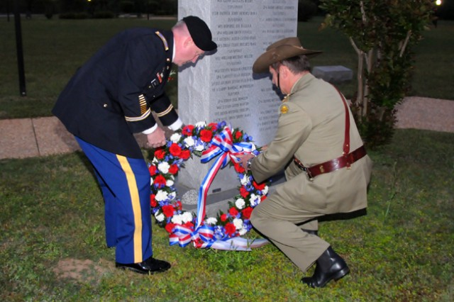 Col. Douglas Gabram, U.S. Army Aviation Center of Excellence deputy commander, and Col. Anton Leshinskas, senior Australian representative, lay a wreath down at the 135th Assault Helicopter Company Memorial in Veterans Park April 25 at a dawn service.