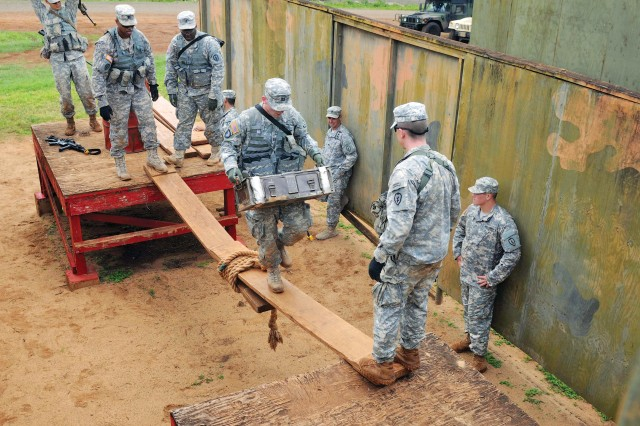 Commanders from 2nd SBCT, 25th ID, participate in a Leader's Reaction Course as part of Warrior X-3, April 3. The exercise was designed to foster communication, adaptability and camaraderie among the commanders and career course captains within the battalions in the brigade.