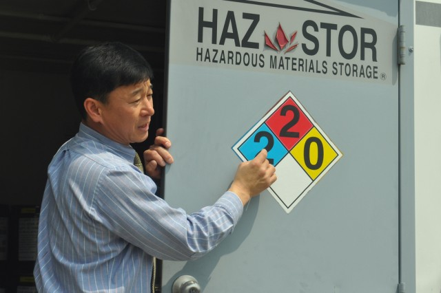 A representative from Yongsan Directorate of Public Works Environmental Division explains the symbol attached on the Hazardous Material Control Center to the environmental experts from Yongsan-gu and Seoul City, May 2. (U.S. Army photo by Pfc. Lim Hong-seo)