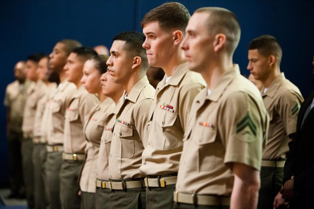 Students of the corporals course class 604-13 stand during their graduation ceremony at Joe Rosenthal Theater on the Henderson Hall portion of Joint Base Myer-Henderson Hall, April 26, 2013. U.S. Marine First Sgt. Christopher Lillie was the guest speaker during the event.