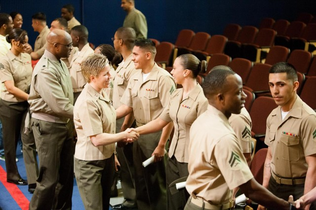 Students of the corporals course class 604-13 stand in a receiving line after their graduation ceremony at Joe Rosenthal Theater on the Henderson Hall portion of Joint Base Myer-Henderson Hall April 26, 2013. U.S. Marine First Sgt. Christopher Lillie was the guest speaker during the event.