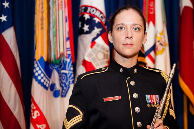 Staff Sgt. Megan Lomonof poses for photographs in Brucker Hall April 29, 2013 on Joint Base Myer-Henderson Hall. Lomonof is part of The U.S. Army Band.