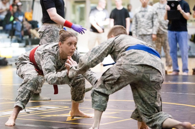 Senior Airman Michael McDonnell, right, 32nd Intelligence Squadron, Fort Meade, Md., competes against Staff Sgt. Megan Lomonof, The United States Army Band, Joint Base Myer-Henderson Hall, during the Joint Force Headquarters-National Capital Region and Military District of Washington 5th Annual Combatives Tournament's welterweight championship bout at the JBM-HH Fitness Center April 18, 2013. Sands went on to win the championship for his weight class. (Joint Base Myer-Henderson Hall PAO Photo by Rachel Larue)