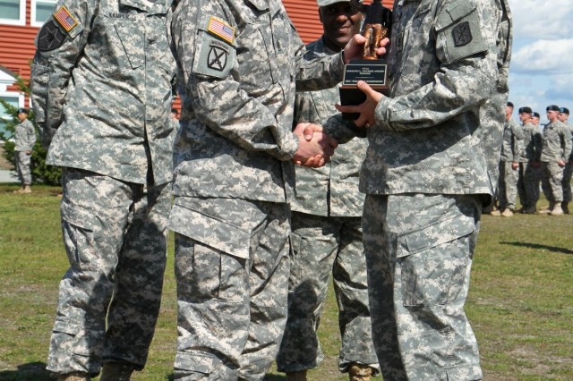 From right, U.S. Army Sgt. 1st Class Thomas A. Robinson, the fire control chief and digital master gunner with 1st Battalion, 377th Field Artillery Regiment, 17th Fires Brigade, is presented with the Edmund L. Gruber Award by Command Sgt. Maj. Sam K. Young,senior enlisted adviser, during an award ceremony at Joint Base Lewis-McChord, Wash., April 30, 2013. The Gruber award is named after Brig. Gen. Edmund L. Gruber, who composed the official Army song, and is awarded to an individual Soldier each year for significant contributions and innovative enhancements to the field artillery corps. (U.S. Army photo by Spc. Nathan Goodall/Released