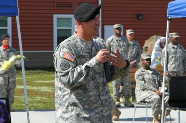 U.S. Army Sgt. 1st Class Thomas A. Robinson, the fire control chief and digital master gunner with 1st Battalion, 377th Field Artillery Regiment, 17th Fires Brigade, speaks after receiving the Edmund L. Gruber Award at Joint Base Lewis-McChord, Wash., April 30, 2013. The Gruber award is named after Brig. Gen. Edmund L. Gruber, who composed the official Army song, and is awarded to an individual soldier each year for significant contributions and innovative enhancements to the field artillery corps. (U.S. Army photo by Spc. Nathan Goodall/Released)