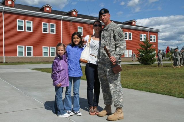 From right, Sgt. 1st Class Thomas A. Robinson, a Newport News, Va., native, and the fire control chief and digital master gunner with 1st Battalion, 377th Field Artillery Regiment, 17th Fires Brigade, with his wife Jennifer and two of their daughters after Robinson was presented with the Edmund L. Gruber Award during an award ceremony at Lewis North, Joint Base Lewis-McChord, Wash., April 30, 2013. The Gruber award is named after Brig. Gen. Edmund L. Gruber, who composed the official Army song, and is awarded to an individual soldier each year for significant contributions and innovative enhancements to the field artillery corps. (U.S. Army photo by Spc. Nathan Goodall, 17th Fires Brigade Public Affairs)