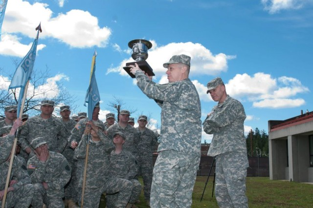 Maj. Gen. Stephen R. Lanza (right), commanding general, 7th Infantry Division, presented the Director's Trophy to Lt. Col. Douglas R. Woodall, commander, 109th Military Intelligence Battalion, 201st Battlefield Surveillance Brigade, 7th Infantry Division, during a ceremony on Joint Base Lewis-McChord, Wash., April 29, 2013. The Directors Trophy is given annually by the Director of the National Security Agency. The 109th MI Bn. Soldiers were recognized with the award for providing critical signals intelligence support while deployed to the Regional Command-East area of operations in Afghanistan.