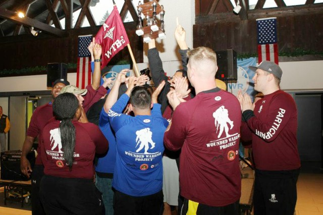 Members of A Company, Warrior Transition Battalion-Europe, celebrate as they receive the Commander's Cup trophy following their triumph over C and D Companies during The Amazing Race: Garmisch on May 1.