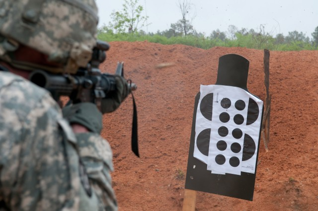 A military police paratrooper with the 82nd Airborne Division's 1st Brigade Combat Team fires at a target close-range, April 30, 2013, at Fort Bragg, N.C., to hone his close quarter's combat firing techniques.