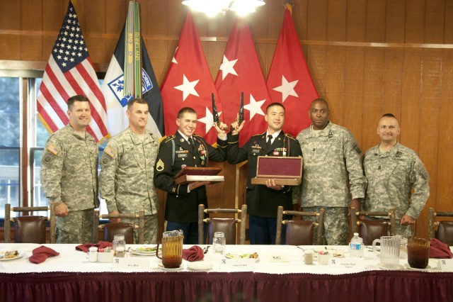 Spc. Lawrence Anderson and Staff Sgt. Cory Schmidt, both representing the 3rd Brigade Combat Team, 82nd Airborne Division, are recognized as the 2013 XVIII Abn. Corps Soldier and Noncomissioned Officer of the Year Apr. 25 at McKellar's Lodge. This is the second year in a row that the Panther Brigade has won the XVIII Abn. Corps NCOY/SOY competition. (U.S. Army Photo by Spc. Paul A. Holston/XVIII Abn. Corps PAO)