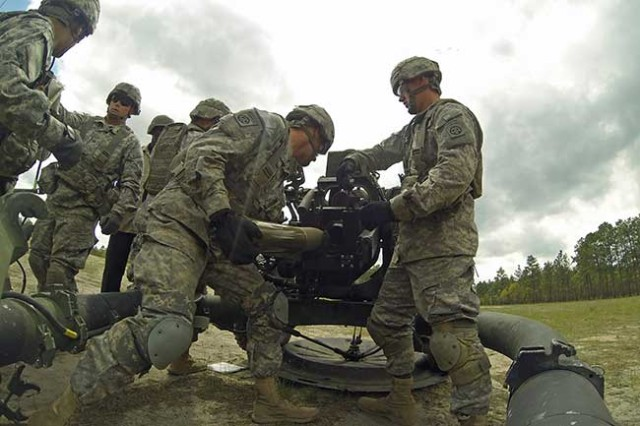 Artillerymen with 3rd Battalion, 319th Airborne Field Artillery Regiment, 1st Brigade Combat Team, 82nd Airborne Division, load a round into the Army's new all-digital M119A3 105 mm lightweight howitzer, April 19. The Gun Devils made history by being the first operational unit in the Army to field and fire the weapon system. (Photo by Staff Sgt. Mary S. Katzenberger/1st BCT, 82nd Abn.)