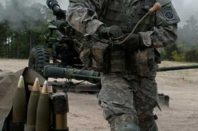Pfc. Benjamen P. Eth, of Battery B, 3rd Battalion, 319th Airborne Field Artillery Regiment, 1st Brigade Combat Team, 82nd Airborne Division, pulls the lanyard to fire the Army's new, all-digital M119A3 105 mm lightweight howitzer, April 19, at Fort Bragg. The Gun Devils made history by being the first operational unit in the Army to field and fire the weapon system. (Photo by Staff Sgt. Mary S. Katzenberger/1st BCT, 82nd Abn.)
