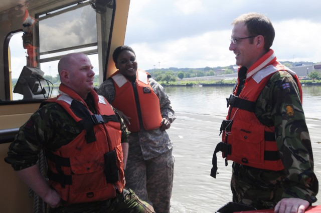 Capt. Matthew Fry (left), Sgt. 1st Class Solitaire Washington (center), and Maj. Robert Duke (right) board the U.S. Army Corps of Engineers, Baltimore District's Debris Vessel 1 in Washington Harbor as part of an Officer's Professional Development training. Photo by Brittany Bangert