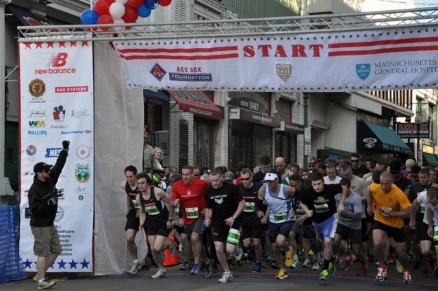 "Runners leave the starting line May 4 in the fourth annual ""Run-Walk to Home Base,"" which benefited service members with post-traumatic stress disorder and traumatic brain injuries. The event drew more than 2,000 participants, including many current service members."