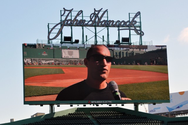 "Sgt. 1st Class Adam Morelli of the U.S. Army Research Institute of Environmental Medicine at Natick Soldier Systems Center appears on the Fenway Park scoreboard May 4 as he is interviewed after the ""Run-Walk to Home Base,"" which benefits service members with post-traumatic stress disorder and traumatic brain injuries. Morelli has suffered from headaches since returning from Iraq."