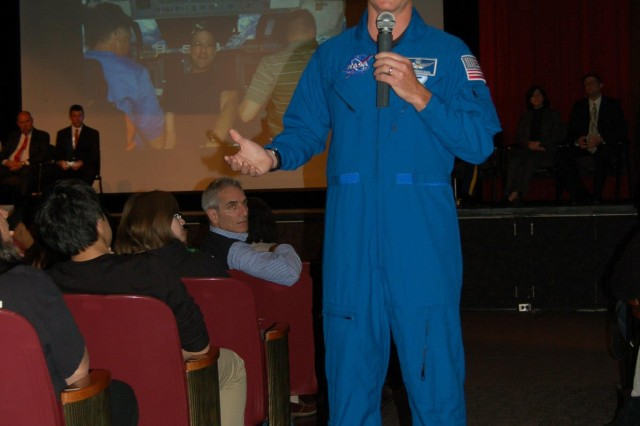 Col. Robert S. Kimbrough, a U.S. Army astronaut assigned to NASA's Johnson Space Center, speaks to a group of people about how astronauts operate in space.