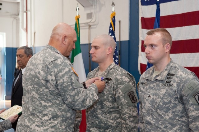 U.S. Army Chief of Staff Gen. Ray Odierno presents the Purple Heart Medal to Sgt. Jeffrey Richey during an award ceremony in Caserma Ederle in Vicenza, Italy, May 1, 2013.  Richey was injured during combat operations in Afghanistan. (U.S. Army photo by Staff Sgt. Teddy Wade/ Released)