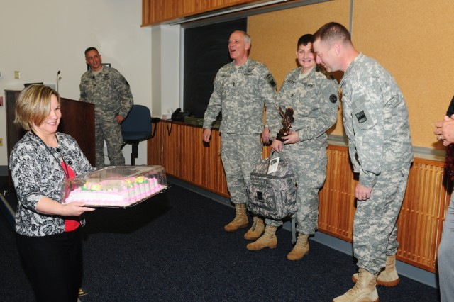 Nydia Negron, 80th Training Command family programs director, surprises Staff Sergeant Jessica Hebler, Headquarters 2nd Brigade, 94th Training Division, with a birthday cake as Maj. Gen. Bill Gerety, commander 80th TC and Command Sgt. Maj. James Wills, senior enlisted leader 80th TC sing happy birthday to Hebler along with unit leaders from across the command during the second Semi-annual Safety and Occupational Health Advisory Council meeting in Richmond, Va. May 4, 2013. Prior to the surprise Hebler received an Exceptional Individual Safety Award.