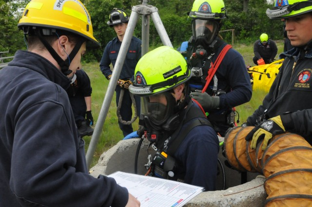 A Prince William County Department of Fire and Rescue special operations team member begins the search for survivors in a confined space during the annual training program called Rescue Challenge.