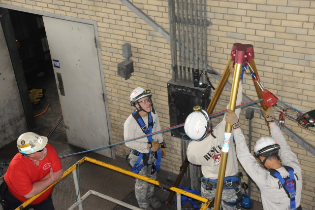 Soldiers from the 911th Technical Rescue Engineer Company prepare a high-line system to traverse a 129 foot chasm during the annual training program called Rescue Challenge 2013.  The Soldiers were inside the cavernous and unused coal fuel section of the Dominium Possum Point Power Station located approximately 30 miles south of DC.