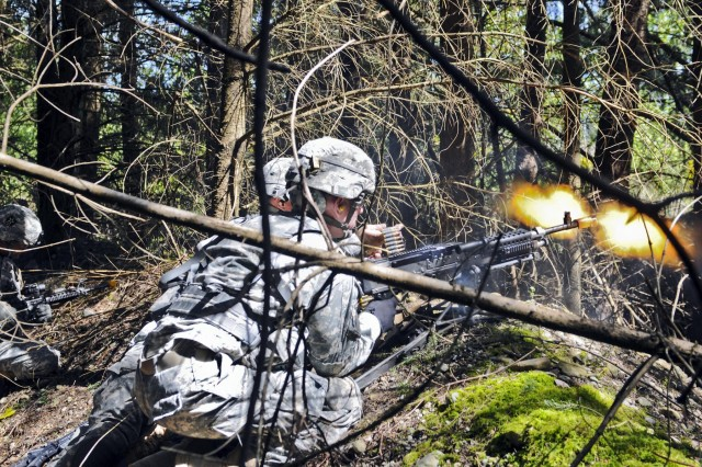 Senior enlisted leaders lay down suppressive fire in a fire fight during the Mangudai Warrior Challenge at Joint Base Lewis-McChord, Wash., May 1. The exercise draws its history from Special Forces units of the Mongol Empire dating back to the 13th Century. It began May 1 and lasted 58-straight hours with minimal food and sleep for the warriors.  (U.S. Army photo by Sgt. Ryan Hallock)