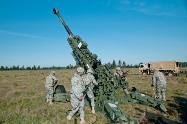 Cannon crew members assigned to the 2nd Battalion, 17th Field Artillery Regiment, place and occupy their weapon, the M777 Howitzer, during a live fire training exercise on Joint Base Lewis-McChord, Wash., May 2. The Batteries of the Steel Battalion spent the day training and live firing rounds from howitzers as part of a twice-a-year requirement to certify on the weapon.