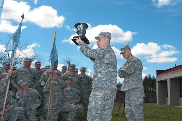 Maj. Gen. Stephen R. Lanza, commanding general, 7th Infantry Division, presented the Director's Trophy to Lt. Col. Douglas R Woodall, commander, 109th Military Intelligence Battalion, during a ceremony on Joint Base Lewis-McChord, Wash., April 29. The Directors Trophy is a prestigious award given annually by the Director of the National Security Agency. The 109th MI Battalion soldiers were recognized with the award for providing critical signals intelligence support while deployed to Regional Command East, Afghanistan.