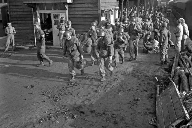 U.S. GROUND TROOPS ARRIVE IN KOREA:  The first units of U.S. Army ground forces to arrive debark from trains somewhere in South Korea.