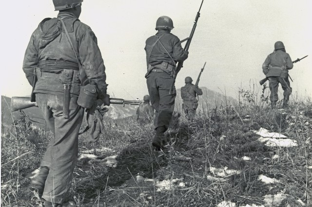 "With air and artillery support, men of Company C, 1st Battalion, 5th Cavalry Regiment, advance on ""Hill 45"" near Ichon, Korea, after three days of bitter fighting for the objective. January 29th, 1951."